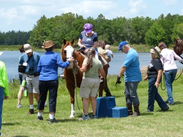 "Giving pony rides at the annual ""Get to Know Colt Creek"""